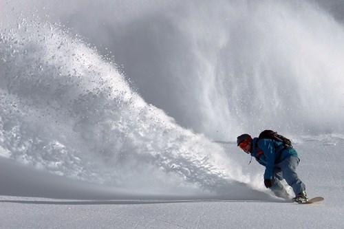 Skiing-in-powder-book-early