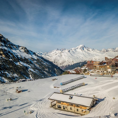 Drone image of Chalet des Cascades in the middle of the piste, Les Arcs