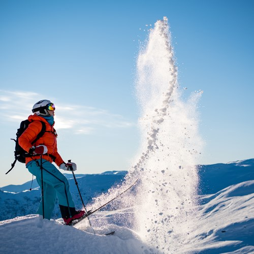flicking snow into the air from a ski, Myrkdalen, ski holiday in Norway