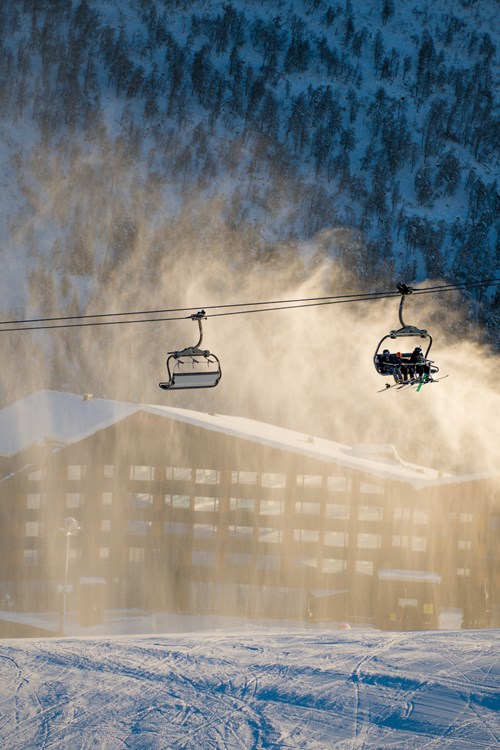 snow cannons and chairlift over Myrkdalen, ski holiday in Norway