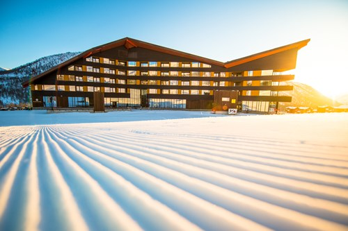 Fresh pistes as the sunrises over the Myrkdalen hotel, ski Norway