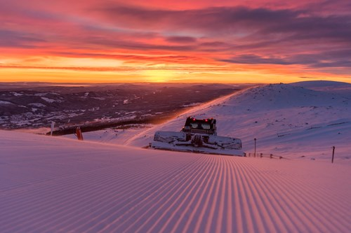 Trysil-Norway skiing holidays-piste machine grooming the runs at sunset
