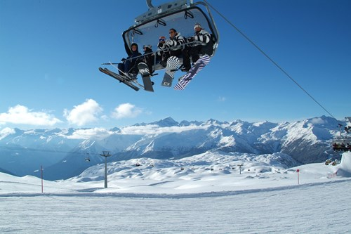 Madonna di Campiglio ski resort-Italy-boarder on chairlift from below