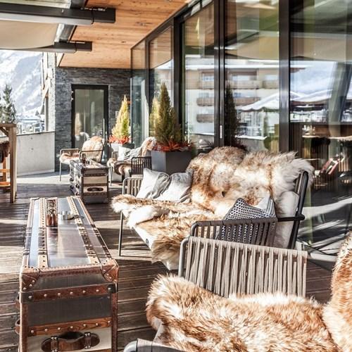 Hotel-Lederer's-Living-Kaprun-design-Hotel-fur-skins-on-the-terrace