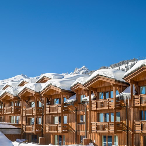 Les-Chalets-du-Forum-Courchevel-1850-exterior apartments in snow