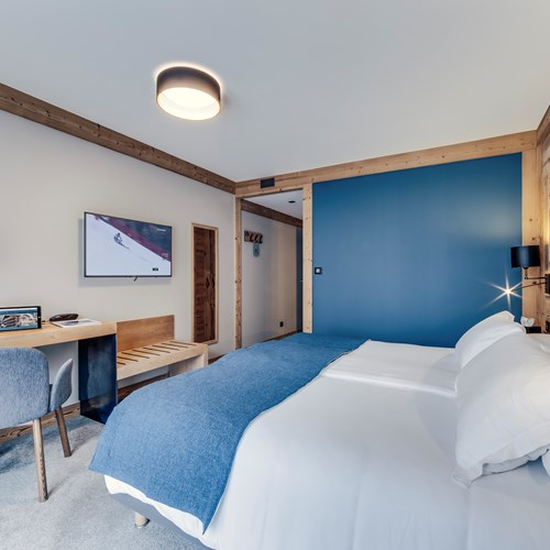Hotel Avancher in Val d'Isere ski resort comfort room blue
