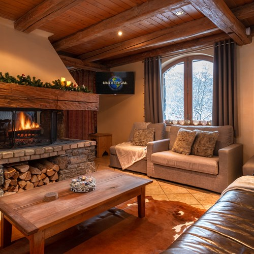 Fireside snug at Chalet Ophelia, ski chalet in Meribel