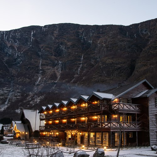 snow covered Flamsbrygga Hotel in Flam, Norway and cliffs