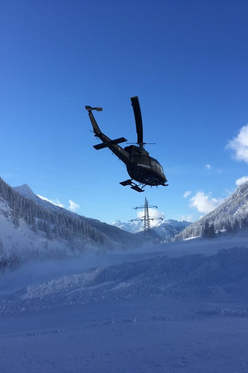 helicopter taking supplies to places cut off by snow in Austria near Stuben
