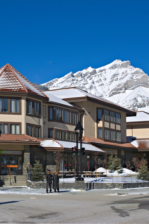 Elf and Avenue Hotel in Banff exterior in blue sky
