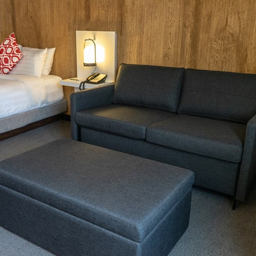 deluxe queen room with sofa and poof Hotel Aava Whistler