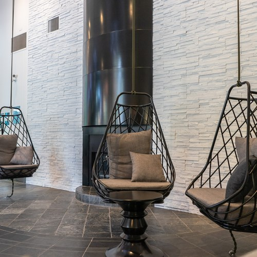 hanging egg chairs at Hotel Aava Whistler