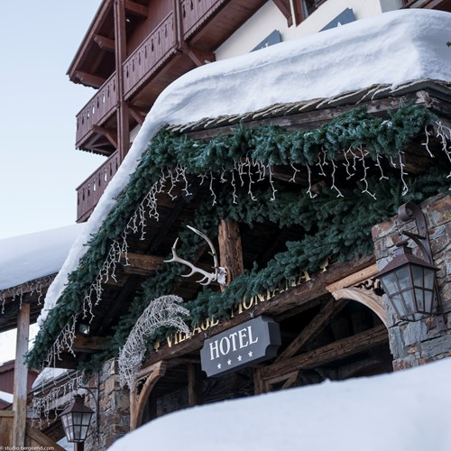 Hotel Village Montana in Tignes hotel sign in snow