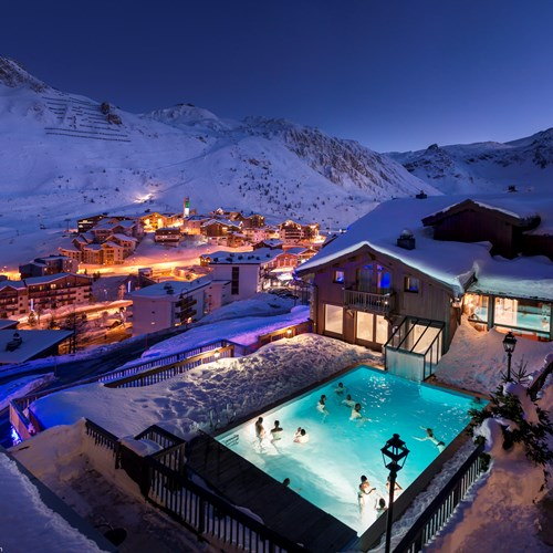 Hotel Village Montana in Tignes outdoor pool lit up at night