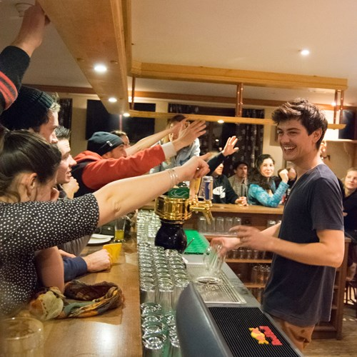 Getting a drink at Bar des Guides, Hotel Suisse bar