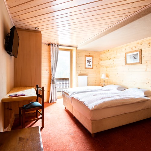 pine clad twin room at Hotel Suisse Champery