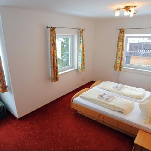 twin room with seating at chalet fauner, catered ski chalet in st anton