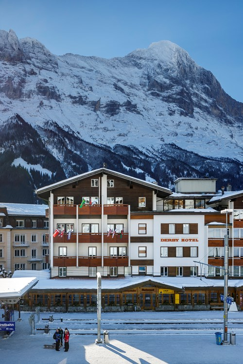 train station and Hotel Derby Grindelwald in the day