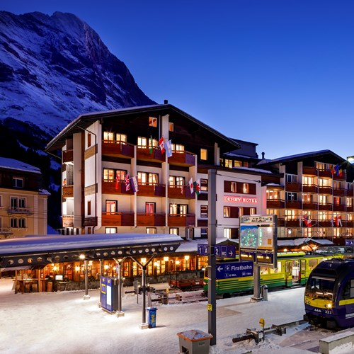 hotel exterior at night with train Hotel Derby Grindelwald