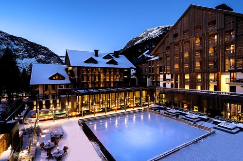the chedi andermatt night time pool view