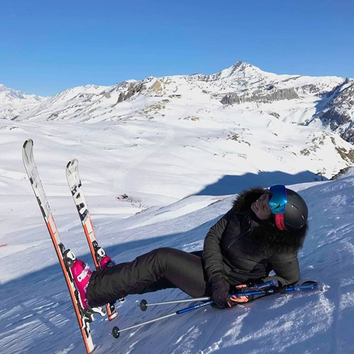 woman lying down on ski slope val d'isere