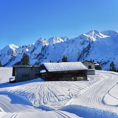 la clusaz mountain hut bluebird day winter