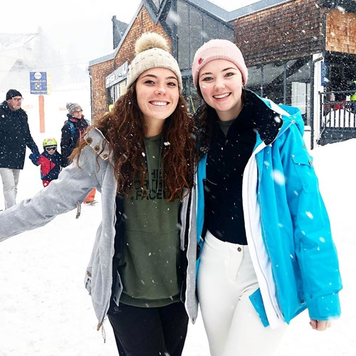 two girls celebrate the snow in st anton
