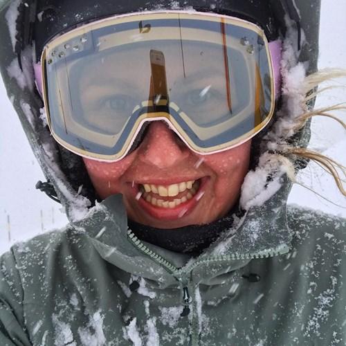 skier takes selfie in snow