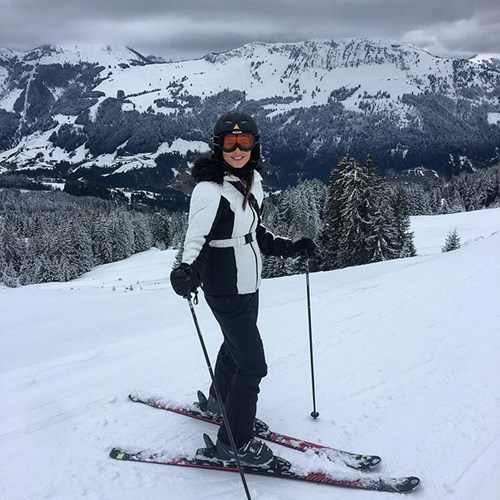 woman standing on skis in ski gear