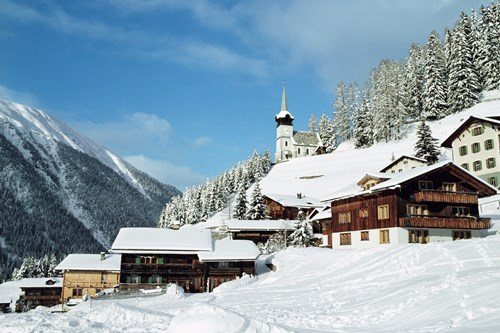 Snow covered klosters village with blue sky