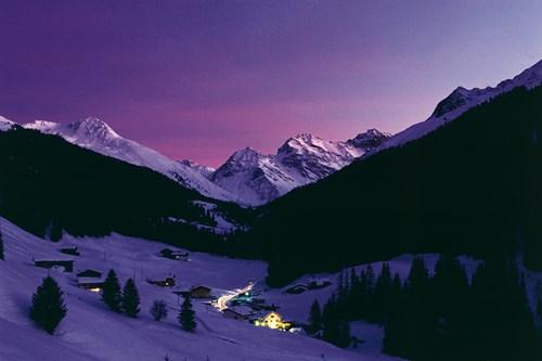 Klosters village at night, purple sky