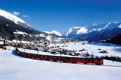 Snow train through the white valley of Klosters in Switzerland