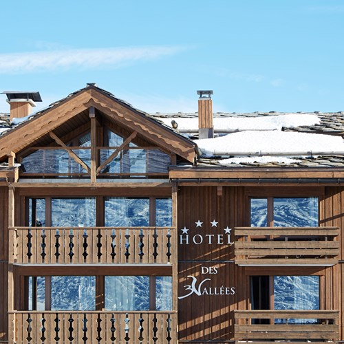 ski in ski out hotel Trois Vallees in Courchevel-exterior and blue skies