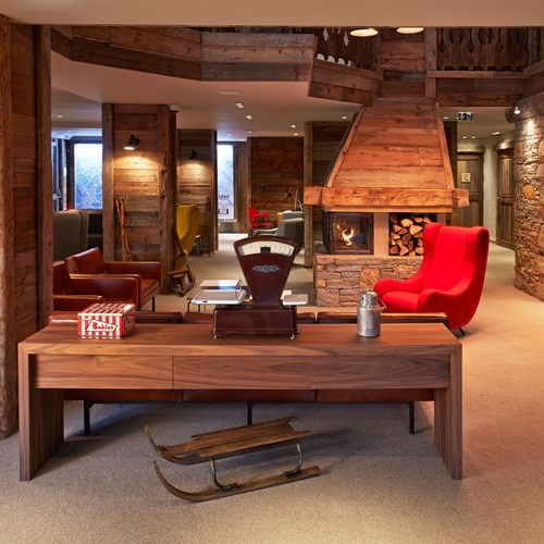 ski in ski out hotel Trois Vallees in Courchevel-open fire and lounge area