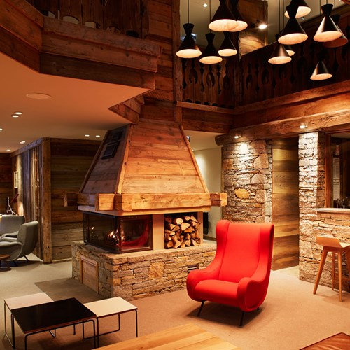 ski in ski out hotel Trois Vallees in Courchevel-fireplace in seating area