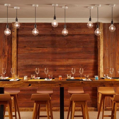 ski in ski out hotel Trois Vallees in Courchevel-wooden dining table