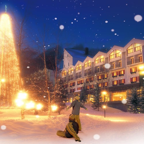 Rusutsu Resort Hotel - Japan skiing - exterior at night with lights