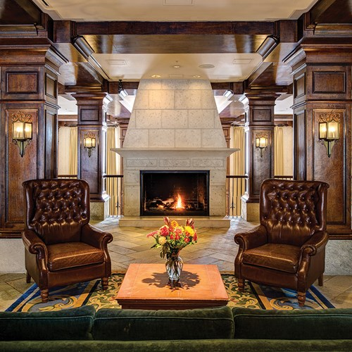 Lobby with armchairs and fire, Sun Peaks Grand ski accommodation in Canada
