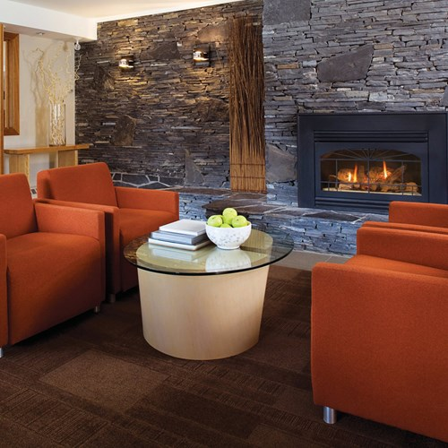 Banff Aspen Lodge, ski hotel in Banff, Canada - lounge and seating by fire