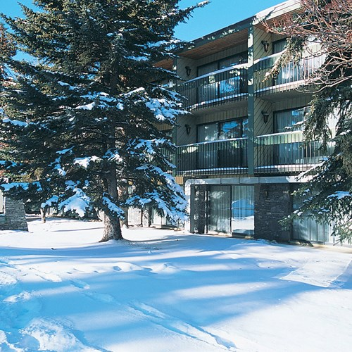 Banff Aspen Lodge, ski accommodation in Banff, Canada - snowy hotel exterio