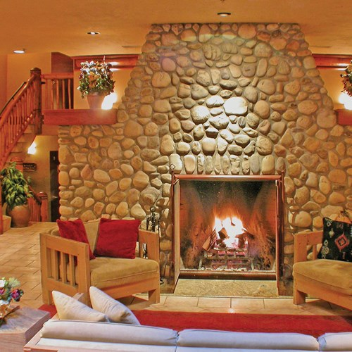 Banff Caribou Lodge & Spa, cosy fire in reception - ski hotel in Canada