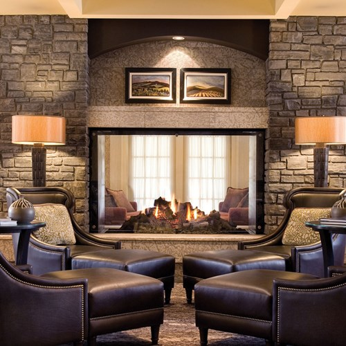 Fairmont Banff Springs, ski hotel in Canada - lounge with luxury fire