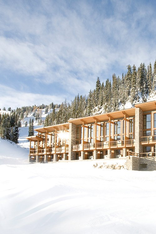 Sunshine Mountain Lodge - snowy exterior of ski accommodation in Canada