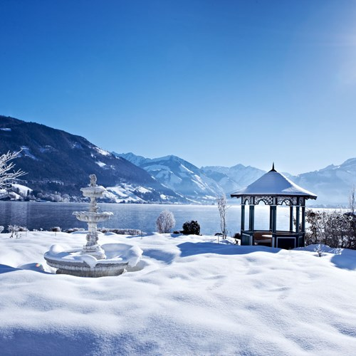 Grand Hotel , ski accommodation in Zell-am-See, view across frozen lake