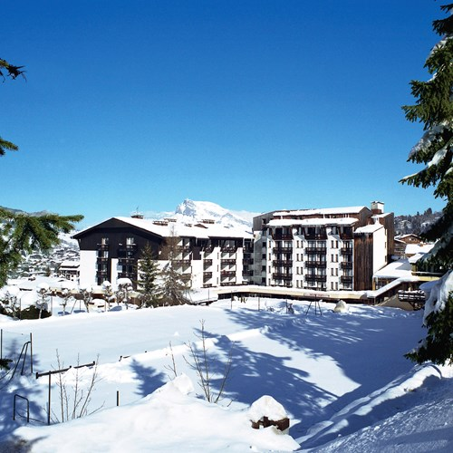 Exterior in the snow at Rochebrune Hotel in Megeve, ski hotel France