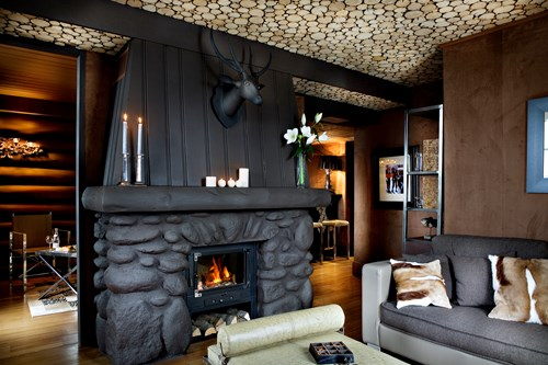 fireplace in lounge area-Le Lodge Park Megeve