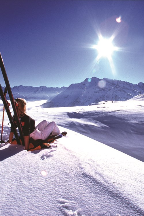 Mayrhofen ski weekends Austria woman leaning on skis above clouds