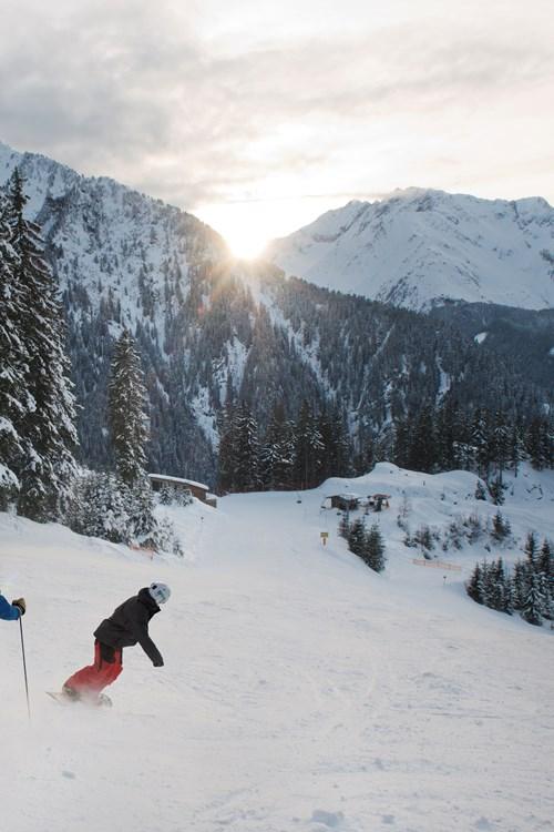 Mayrhofen ski weekends Austria skier and boarder sunset mountains