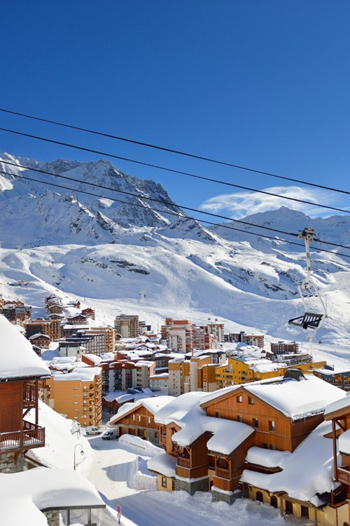 chairlift over-Val-Thorens-France-snow capped village