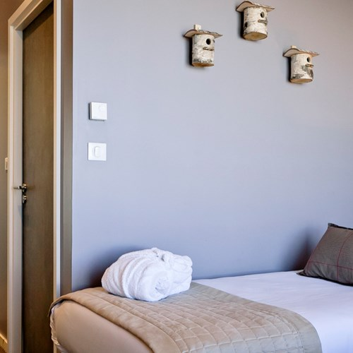 Aiguille Grive Chalets hotel, slope-side ski hotel in Les Arcs, twin room